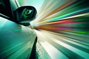 15737311_-_pov_shot_of_car_driving_in_city__blurred_motion