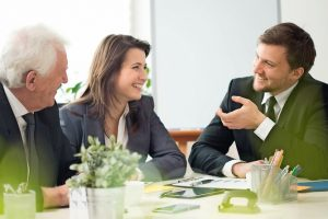 34889701_-_business_people_laughing_during_business_appointment_in_the_office