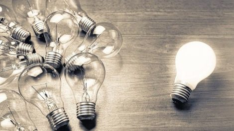 White_light_bulb_glowing_separate_from_others