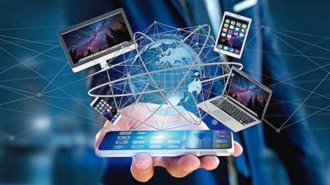 View_of_a_Businessman_holding_a_Computer_and_devices_displayed_on_a_smartphone_interface_with_international_network__-_3d_render