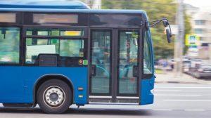_city_bus_goes_along_street