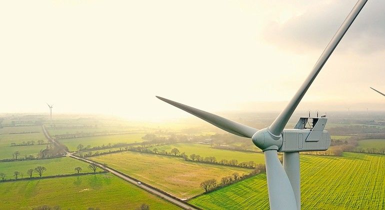 Aerial_photo_of_wind_turbines_at_sunset_in_Sainte_Pazanne,_France