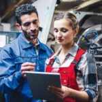 Woman_and_man_manufacturing_worker_in_discussion_writing_on_tablet_computer_