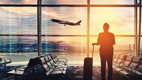 Silhouettes_passenger_airport._Airline_travel_concept.