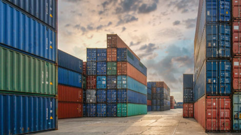 perspective_view_of_containers_at_containers_yard_with_forklift_and_truck