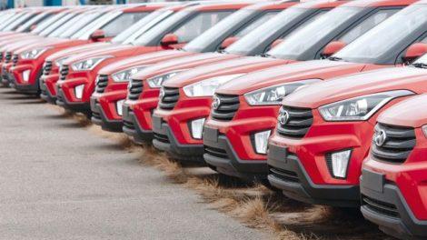 Minsk,_Belarus._Mar_2020._Hyundai_cars_parked_in_row_the_parking_lot_of_an_authorized_dealer._New_cars_on_holding_yard._Blue_Hyundai_Creta,_ix25_vehicles_on_the_parking_in_row._New_cars_for_sale