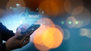 Close_up_of_Woman_hands_using_mobile_smart_phone_for__online_payment_and_banking_and_online_shopping_,Social_distancing_and_Working_from_home_concept.