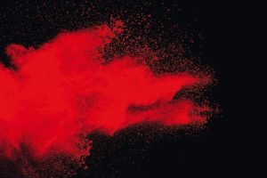 Red_color_powder_explosion_on_black_background.Freeze_motion_of_red_dust_particles_splashing.