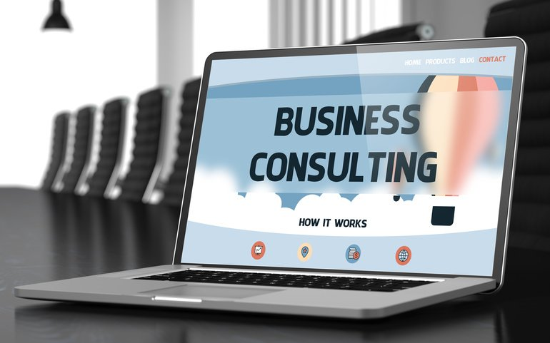 Laptop_Display_with_Business_Consulting_Concept_on_Landing_Page._Closeup_View._Modern_Conference_Hall_Background._Blurred_Image._Selective_focus._3D_Illustration.