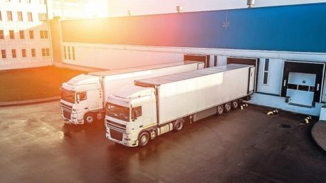 trucks_are_loaded_in_a_modern_logistics_center__