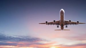 Commercial_airplane_jetliner_flying_above_dramatic_clouds_in_beautiful_sunset_light._Travel_concept.