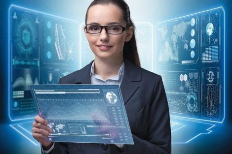 Businesswoman_with_tablet_in_data_mining_concept