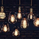 Beautiful_vintage_luxury_light_bulb_hanging_decor_glowing_in_dark._Retro_filter_effect_style.