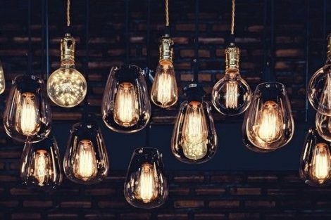 Beautiful_vintage_luxury_light_bulb_hanging_decor_glowing_in_dark._Retro_filter_effect_style.