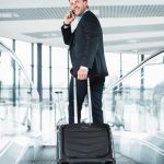 Businessman_with_suitcase_at_the_airport