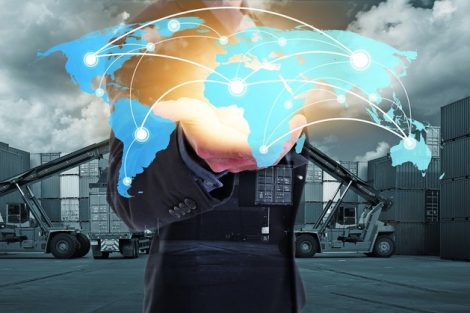 Global_network_coverage_world_map_on_hand_of_businessman,_Industrial_Container_Cargo_yard_for_Logistics_Import_Export._(Elements_of_this_image_furnished_by_NASA)