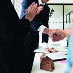 Estate_agent_shaking_hands_with_his_customer_after_contract_signature_and_congratulation
