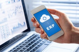 ERP_(Enterprise_Resource_Planning)_app_on_smartphone_screen_connecting_data_with_cloud_computing,_access_to_HR_management,_production_control,_accounting