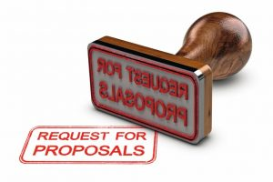 Request_for_proposals_printed_on_a_white_background,_with_rubber_stamp,_RFP_concept._3D_illustration