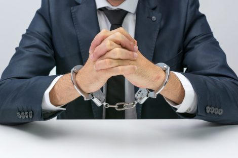 Businessman_with_handcuffs