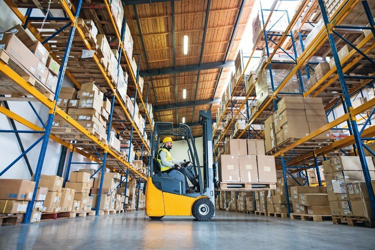 Man_forklift_driver_working_in_a_warehouse.