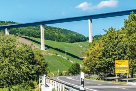 TRIER,_GERMANY_-_September_13,_2019_-__High_Moselle_Bridge_construction_with_highway_and_street_sign_-_TRIER_Germany