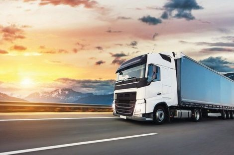 European_truck_vehicle_on_motorway_with_dramatic_sunset_light._Cargo_transportation_and_supply_theme.
