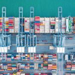 Aerial_top_view_container_cargo_ship,_Business_import_export_logistic_and_transportation_of_International_by_containr_cargo_ship_in_the_open_sea.