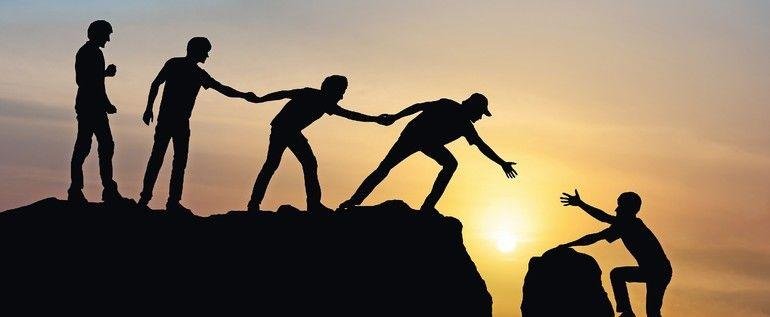 Group_of_people_on_peak_mountain_climbing_helping_team_work_,_travel_trekking_success_business_concept