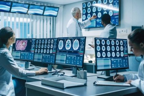 _Neuroscientists_Surrounded_by_Monitors_Showing_CT,_MRI_Scans_Having_Discussions_and_Working_on_Personal_Computers.
