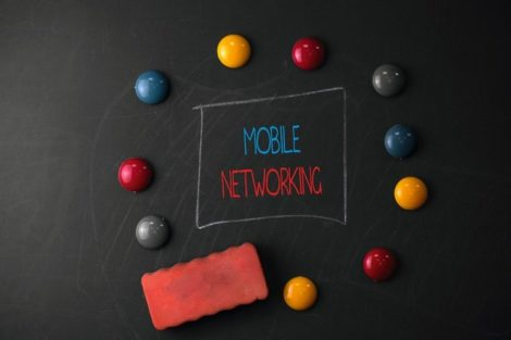 Conceptual_hand_writing_showing_Mobile_Networking._Concept_meaning_Communication_network_where_the_last_link_is_wireless_Round_Flat_shape_stones_with_same_sizes_stick_black_board
