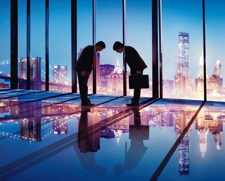 31335779_-_japanese_businessmen_having_a_business_agreement