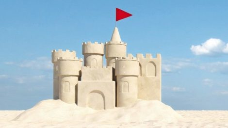 Beautiful_sandcastle_on_the_beach_with_sand_on_summer_vacation_(3d_rendering)