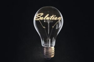 Glowing_glass_light_bulb_with_word_solution_inside
