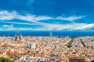 Panoramic_view_of_Barcelona_from_Park_Guell_in_a_summer_day_in_Spain