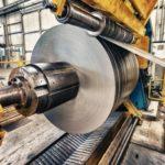 Metal_coils_machine._Interior_of_factory._Business_concept.