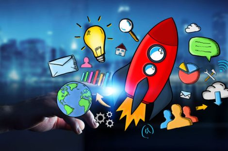 67653705_-_businessman_on_dark_background_touching_hand_drawn_rocket_with_his_finger
