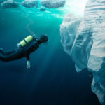 Diver_exploring_the_formations_under_the_pack_ice_near_the_arctic_circle._
