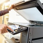 Bussiness_man_Hand_press_button_on_panel_of_printer,_printer_scanner_laser_office_copy_machine_supplies_start_concept.