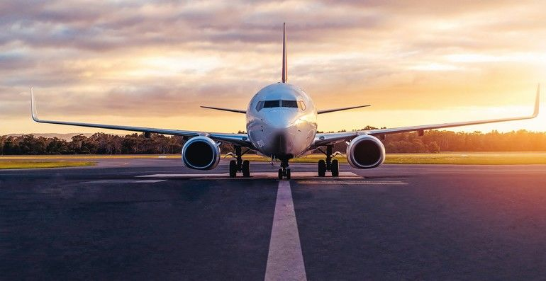 Sunset_view_of_airplane_on_airport_runway_under_dramatic_sky_in_Hobart,Tasmania,_Australia._Aviation_technology_and_world_travel_concept.