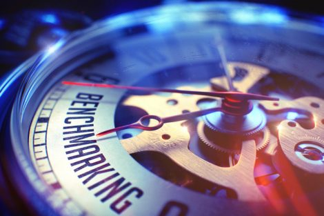Watch_Face_with_Benchmarking_Text_on_it._Business_Concept_with_Lens_Flare_Effect._Benchmarking._on_Vintage_Watch_Face_with_CloseUp_View_of_Watch_Mechanism._Time_Concept._Lens_Flare_Effect._3D.
