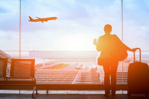 happy_traveler_waiting_for_the_flight_in_airport,_departure_terminal,_immigration_concept