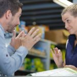 impatient_customer_talking_to_sales_clerk_in_hardware_store