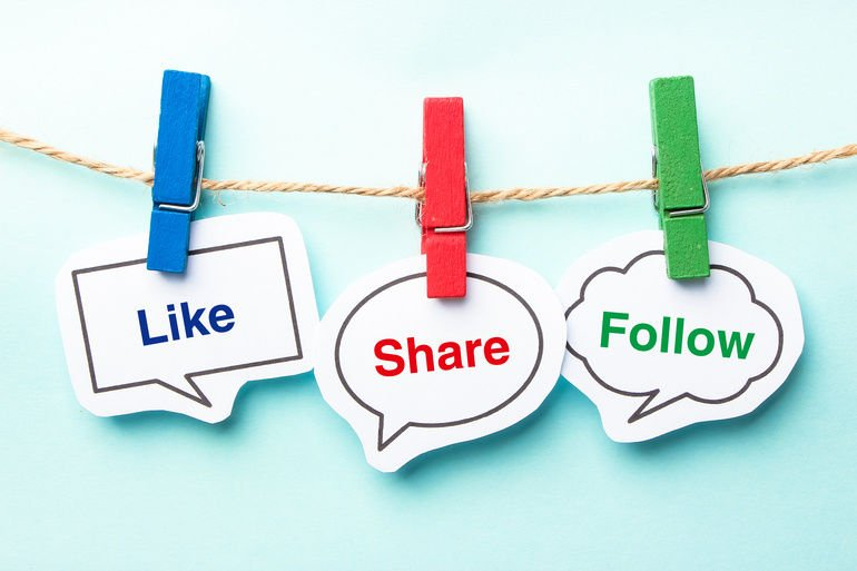 Like_share_follow_bubble_with_clip_hanging_on_the_line_with_blue_background.