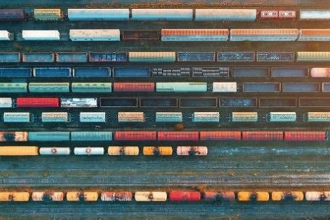 Top_view_of_cargo_trains._Aerial_view_from_flying_drone_of_colorful_freight_trains_on_the_railway_station._Wagons_with_goods_on_railroad._Heavy_industry._Industrial_conceptual_scene_with_trains.