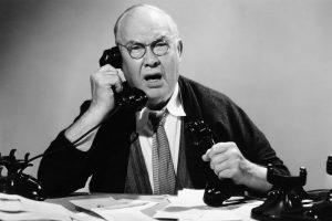 Businessman_using_multiple_phones