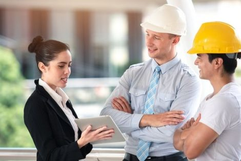 Project_Manager_Working_and_Discusses_with_Professional_Engineering_Team_Training_on_Construction_Site_and_Building_-_Teamwork_Business_Concept