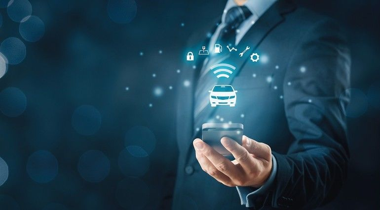 Intelligent_car,_intelligent_vehicle_and_smart_cars_concept_with_smart_phones._Symbol_of_the_car_and_information_via_wireless_communication_about_security,_parking_location,_fuel,_drive_analysis,_service_and_car_settings.