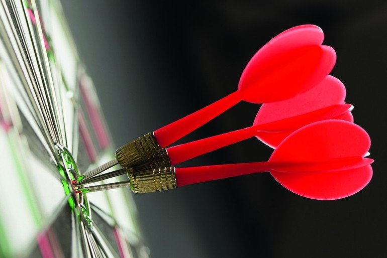 Three_red_darts_pinned_right_on_the_center_of_target