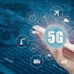5G_network_wireless_systems_and_internet_of_things,_Smart_city_and_communication_network_with_smartphone_in_hand_and_objects_icon_connecting_together,__Connect_global_wireless_devices.
